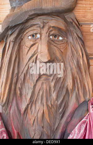 Sad-faced cowboy wood carving, roadside attraction in Davenport, Washington State, USA. - Stock Image