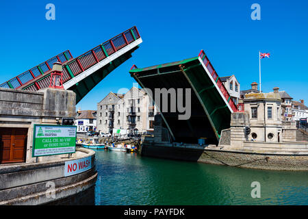 Weymouth bridge rising ready for a boat to pass, Dorset, UK. - Stock Image