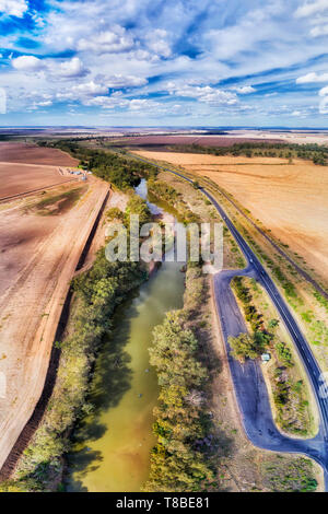 REst area on Newell highway out of Moree town in rural remote outback region of Australia. Rest area by Gwydir river between flat cultivated farms in  - Stock Image