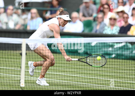 Wimbledon, UK. 11th July 2019, The All England Lawn Tennis and Croquet Club, Wimbledon, England, Wimbledon Tennis Tournament, Day 10; Simona Halep (rom) net volley as she takes control of the game against Elina Svitolina (ukr) during their ladies singles semi-final match Credit: Action Plus Sports Images/Alamy Live News - Stock Image