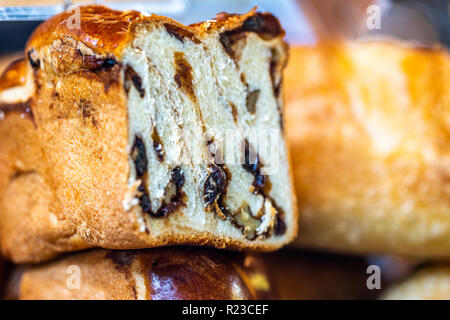 Brioche style sweet loaf with cinnamon, walnuts, raisins. Homemade poppy seed braided bread, close up selective focus. National pastries. - Stock Image