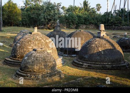 Stone stupas at Kadurugoda Vihara ancient Buddhist temple in Jaffna, Sri Lanka - Stock Image