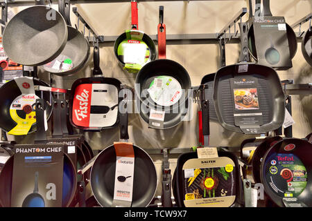 Display of frying pans on sale in store - Stock Image