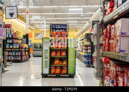 Inside a Walmart store showing snacks and diaper aisles. USA. - Stock Image