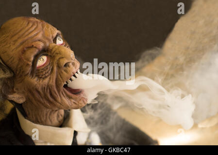 Creepy dead man mas breathing fog - Stock Image