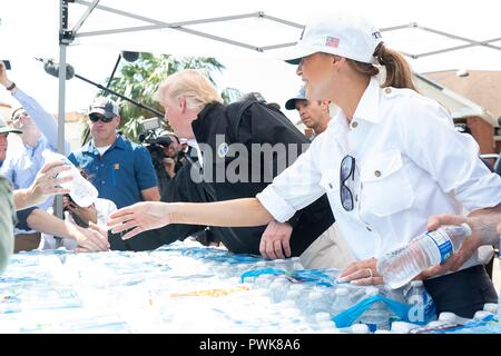 Panama City, Florida, USA. 15th Oct 2018. U.S President Donald Trump and First Lady Melania Trump pass out bottles of water to victims of Hurricane Michael October 15, 2018 in Lynn Haven, Florida. Credit: Planetpix/Alamy Live News - Stock Image