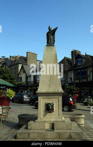 Fountain and statue of Saint Samson in Grande Rue des Stuarts, Dol de Bretagne, Ille et Vilaine, Brittany, France - Stock Image