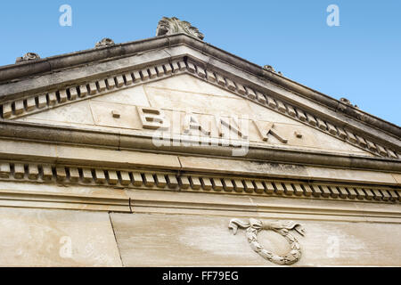 Bank sign on a old stone bank building exterior - Stock Image