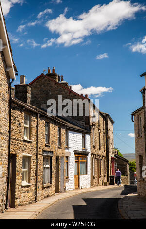 UK, Cumbria, Sedbergh, Main Street, traditional two and three storey stone-built houses in old part of town - Stock Image