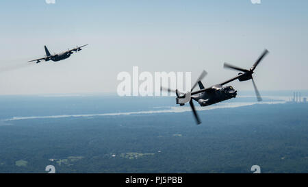 An 8th Special Operations Squadron CV-22 Osprey tiltrotor aircraft flies alongside a 15th Special Operations Squadron MC-130H Combat Talon II above Virginia, Aug. 24, 2018. Aircraft from the 1st Special Operations Wing, Hurburt Field, Florida, performed a flyover above the Air Force Memorial in Arlington, Virginia, honoring U.S. Air Force Tech. Sgt. John Chapman, a Special Tactics combat controller, who was posthumously awarded the Medal of Honor for his extraordinary heroism during the Battle of Takur Ghar in March 2002 while deployed to Afghanistan.  Chapman is the 19th Airman to receive the - Stock Image