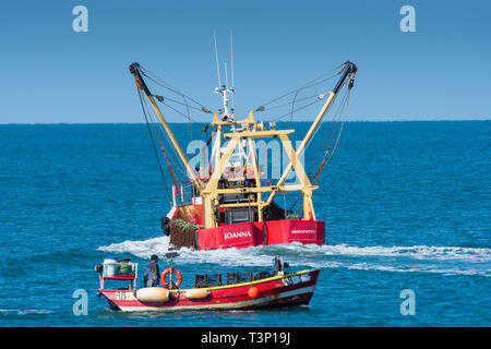 Aberystwyth Wales, UK. 11th Apr, 2019. UK Weather: Local inshore fishermen out in their small boats on the calm sea on a gloriously bright and sunny morning in Aberystwyth on the Cardigan Bay coast of west Wales.