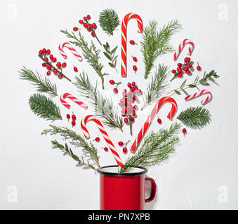 Christmas decoration,fir branch,berries and red cup,flat lay. - Stock Image
