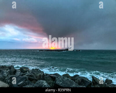 Mousehole, Cornwall, UK. 23rd November 2018. UK Weather. With a yellow forecast for rain for the day, dark storm clouds move into Cornwall at sunrise. Credit: Simon Maycock/Alamy Live News - Stock Image