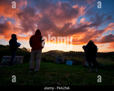 Wirksworth, Derbyshire, UK. 21st June, 2018. Summer solstice UK: Pagan's celebrating the sun rising on the summer estival solstice at the star disc above Wirksworth in the Derbyshire Dales. UK Weather, sunrise in Derbyshire of the longest day of the year. Credit: Doug Blane/Alamy Live News - Stock Image