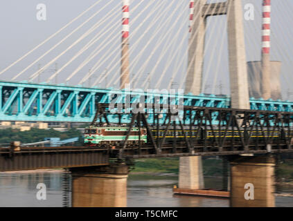(190423) -- CHONGQING, April 23, 2019 (Xinhua) -- The last train runs on the previous Baishatuo Yangtze River railway bridge in Jiangjin of southwest China's Chongqing Municipality, April 23, 2019. The previous Baishatuo Yangtze River railway bridge, completed in 1959, will stop service after April 24. All trains will run on the new double decker steel truss cable stay railway bridge after that day. The new bridge has 4 tracks on the upper deck for passenger trains with a designed speed of 200 kilometers per hour and 2 tracks on the lower deck for cargo trains with the designed speed of 120 ki - Stock Image
