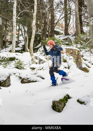 Low angle view of a Girl snowshoeing in Black Forest, Germany, Europe - Stock Image