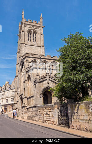 Sunlit St John's Church with blue sky, Stamford, Lincolnshire, England, UK - Stock Image