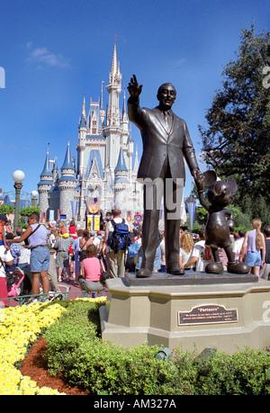 Disney Castle and statue of Walt Disney Magic Kingdom Disneyland Orlando Florida USA - Stock Image