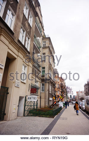 Poznan, Poland - March 8, 2019: People passing a antique shop on the Slowackiego street. - Stock Image