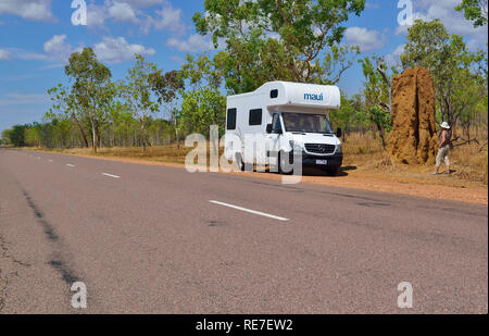 Motorhome tourist stops on the road side to look at a cathedral termite mound one of most iconic sites in Kakadu Northern Territories Australia - Stock Image