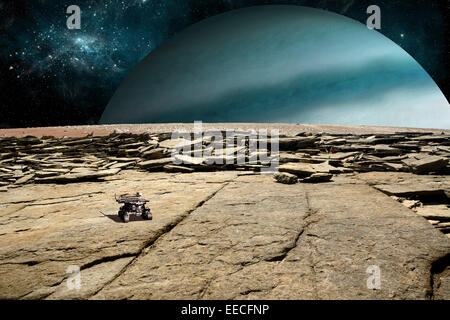 A rover explores the surface of a rocky and barren moon. A large Jupiter-like planet rises over the horizon. - Stock Image
