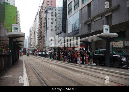 People queuing at Tram station in North Point, Hong Kong - Stock Image