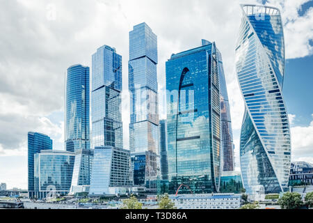 Shopping business center in Moscow city of skyscrapers against the background of a summer cloudy sky - Stock Image