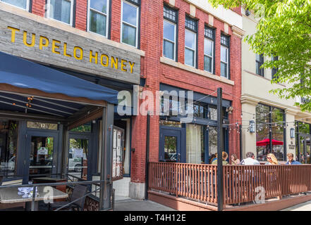 ASHEVILLE, NC, USA-4/11/19: The Tupelo Honey Restaurant, with customers at outside seating, on College St., in downtown on a spring day. - Stock Image