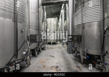 Modern winery interior with aluminium tanks with controlled cooling system - Stock Image