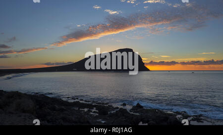 Early sunrise over Montana Roja, an unusual, stratovolcanic cone and La Tejita beach, one of the longest, natural beaches in Tenerife, Canary Islands - Stock Image
