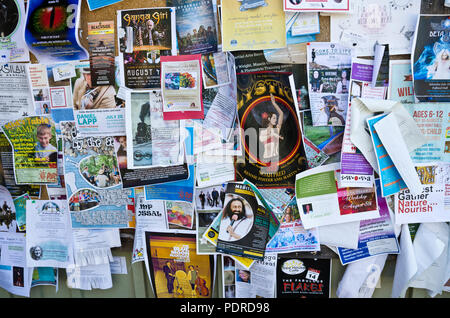 Notice board on Salt Spring Island, BC, Canada.  Posters advertising art, music, and new age events and classes. - Stock Image