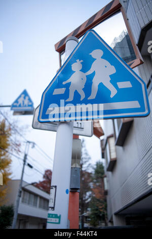 Blue and white child crossing signs - Stock Image