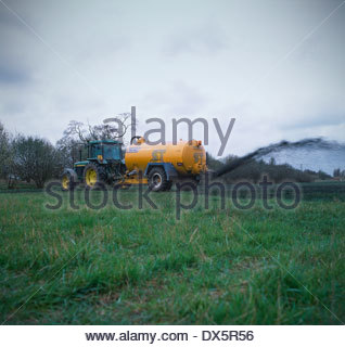Sewage sludge being spread on field, Staffordshire, UK - Stock Image