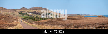 Panoramic image of lone cyclist by Loch Ewe, Poolewe, west coast of Scotland. - Stock Image