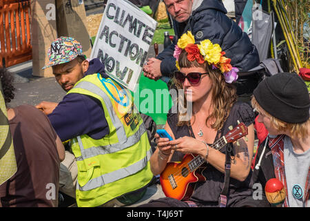 London, UK. 17th April 2019. Two days after Extinction Rebellion closed Waterloo Bridge turning it into a 'Garden Bridge' it remains closed to traffic despite a couple of hundred arrests. Activities continue on the bridge with new protesters arriving. Credit: Peter Marshall/Alamy Live News - Stock Image