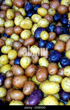 Steamed & salted purple Yukon gold & red jacket baby potatoes - Stock Image