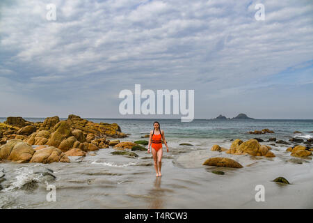 Cot Valley, near Lands End, Corn wall, UK. 18th Apr, 2019. UK Weather. Katie from Penzance out for a morning swim in the sunshine at the secluded beach at Cot Valley, near Lands End. Credit: Simon Maycock/Alamy Live News - Stock Image