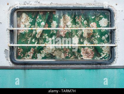 Curtains on old caravan. - Stock Image