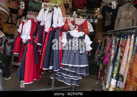 Traditional Austrian children's clothes for sale on a stall at Naschmarkt, Vienna, Austria - Stock Image