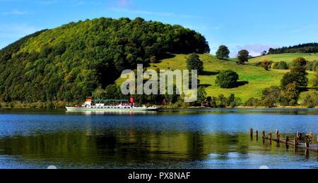 Passenger ferry,steamer boat, on Ullswater lake, that runs between Pooley Bridge and Glenridding. Lake District national park, Cumbria, England, UK - Stock Image