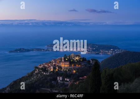 Sunrise on the Village of Eze (Èze), the Mediterranean Sea and Saint-Jean-Cap-Ferrat. Alpes-Maritimes, French Riviera, France - Stock Image
