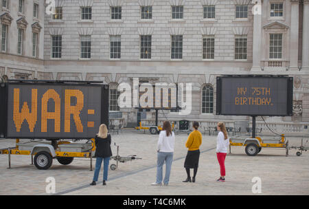 London, UK. 16th April, 2019. Earth Day season. Reduce Speed Now! (2019), by American artist Justin Brice Guariglia is unveiled - a large-scale installation in Somerset House courtyard formed of nine solar-powered LED signs featuring speeches, poems, literature and more from key environmental activists around the world including the 16 yr-old Swedish activist, Greta Thunberg, is previewed. Credit: Malcolm Park/Alamy Live News. - Stock Image