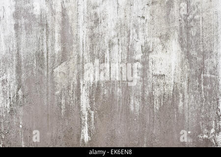 Peeling paint on a weathered metal surface as a background - Stock Image