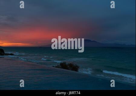 Beautiful Sunrise at Zakynthos and in the background Kefalonia island - Stock Image