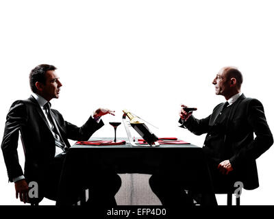 two businessmen dinning in silhouettes on white background - Stock Image