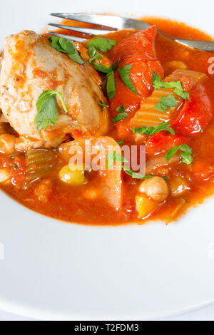 A plated dish of Spanish Chicken, Red pepper and olive stew - Stock Image