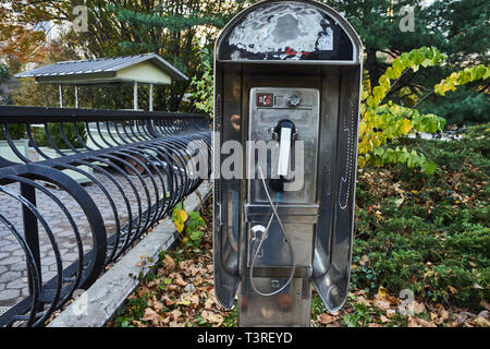 non working Telephone booth in Central Park - Stock Image