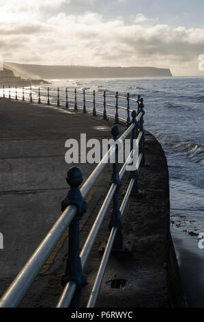 Sunset over Whitby beach on the North Yorkshire coast - Stock Image