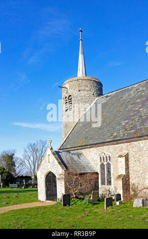 A view of the South Porch and Tower of the Church of St Mary the Virgin on the North Norfolk coast at Titchwell, Norfolk, England, UK, Europe. - Stock Image