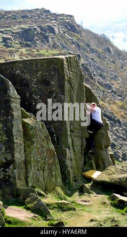 Curbar Edge, Peak District, Derbyshire, UK. 3rd April, 2017. UK Weather, rock climber bouldering at Curbar Edge - Stock Image